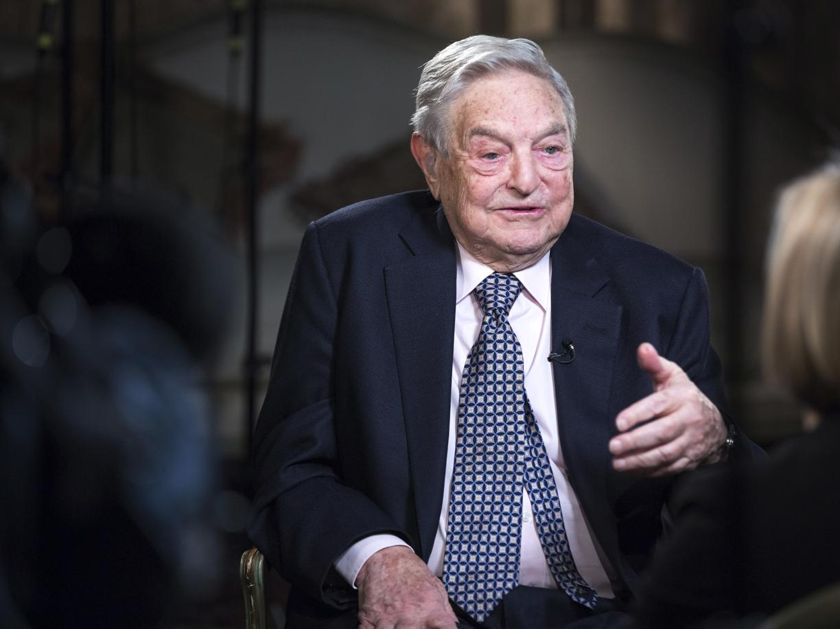 George Soros, billionaire and founder of Soros Fund Management LLC, speaks with Bloomberg Television anchor Francine Lacqua, right, during an interview recorded at his home in London, U.K., on Monday, March 24, 2015. The chances of Greece leaving the euro area are now 50-50 and the country could go down the drain, billionaire investor Soros said. Photographer: Jason Alden/Bloomberg via Getty Images